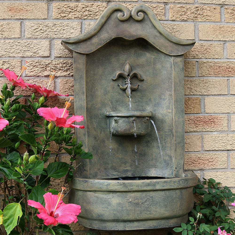 Sunnydaze Flower Of France Solar Wall Fountain Florentine Stone Photo