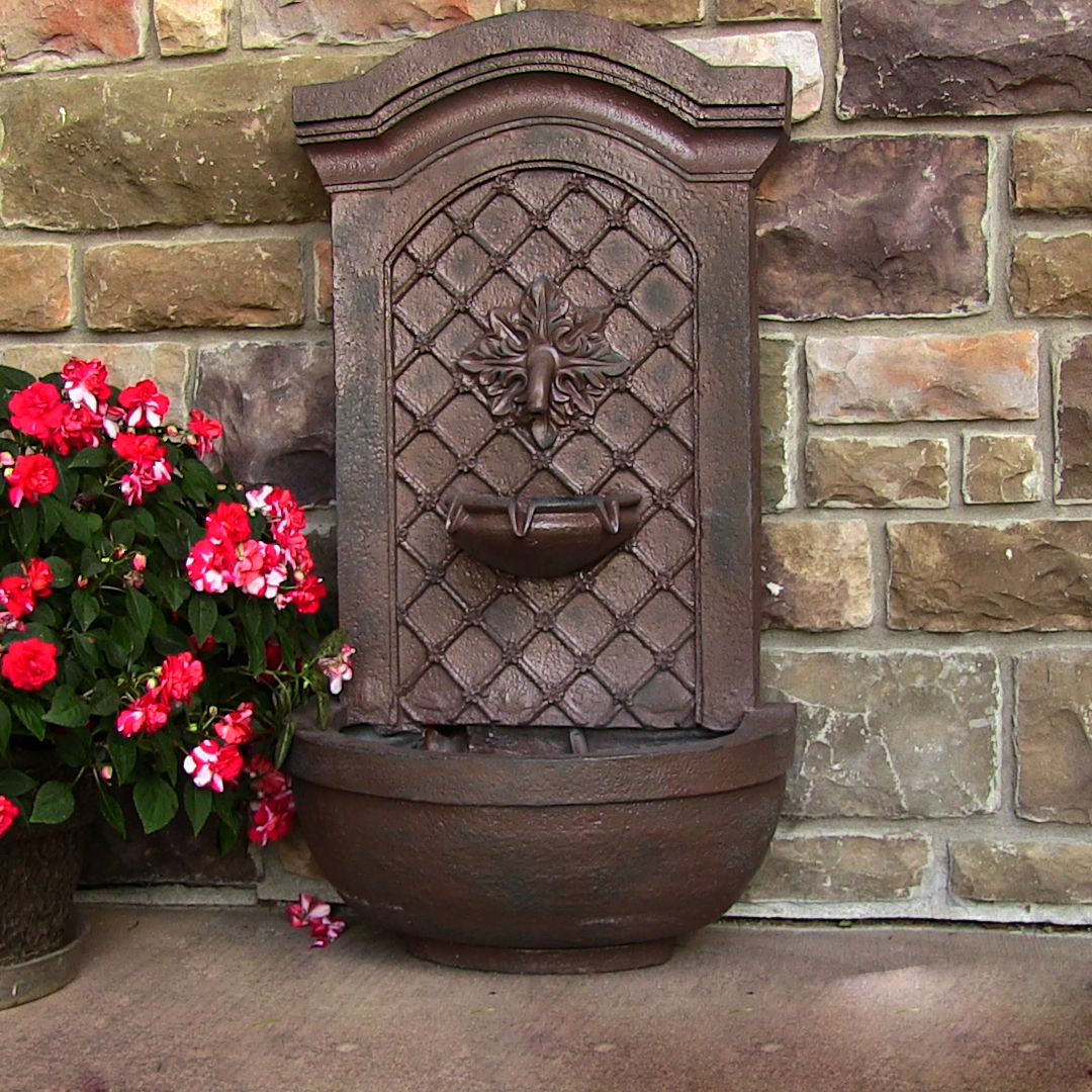 Sunnydaze Rosette Solar Wall Fountain Weathered Iron Solar Only Feature Photo